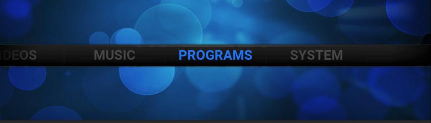 """חזרו חזרה למסך הבית ולחצו על """"Programs"""""""
